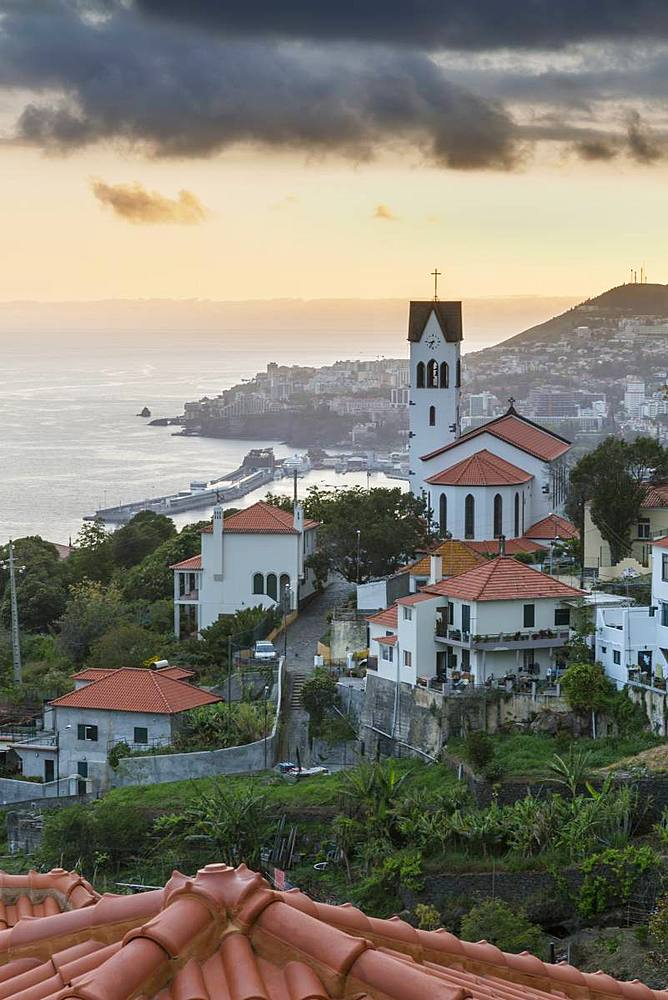 View of Church of Sv?o Gonv?alo overlooking Funchal harbour and town at sunset, Funchal, Madeira, Portugal, Europe