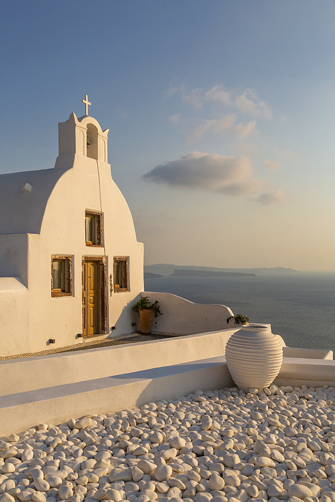 View of traditional white washed Church at sunset in Oia, Santorini, Greek Islands, Greece, Europe
