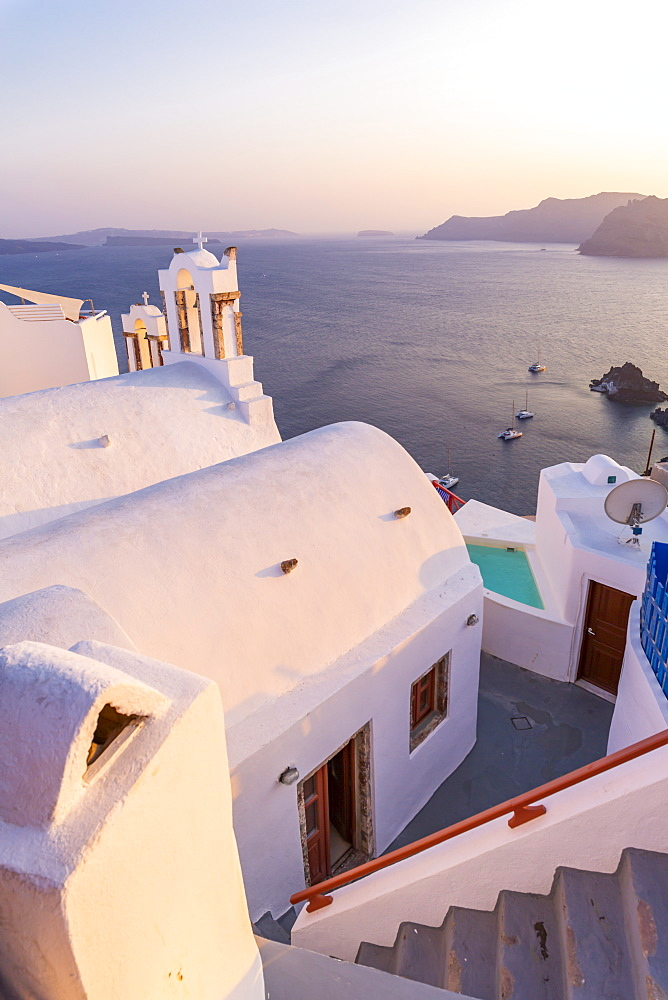 View of traditional blue domed church in Oia, Santorini, Cyclades, Aegean Islands, Greek Islands, Greece, Europe