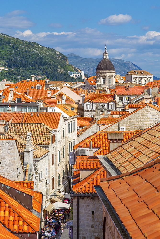 View of red rooftops and Dubrovnik Cathedral, Dubrovnik Old Town, UNESCO World Heritage Site, and Adriatic Sea, Dubrovnik, Dalmatia, Croatia, Europe