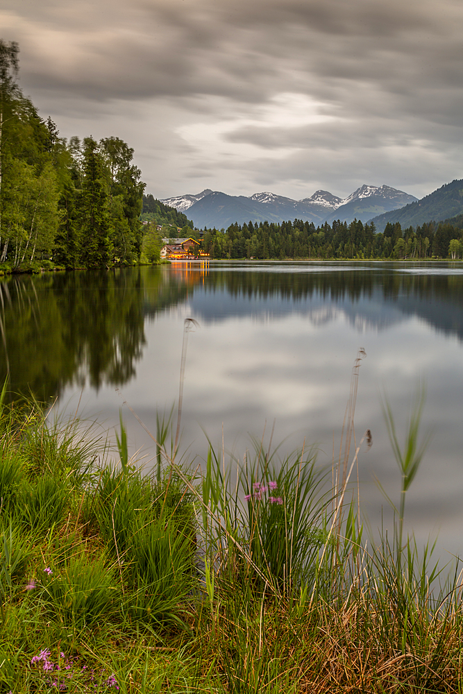 Lake side bar and mountainous backdrop at Schwarzsee near Kitzbuhel, Tyrol, Austria, Europe