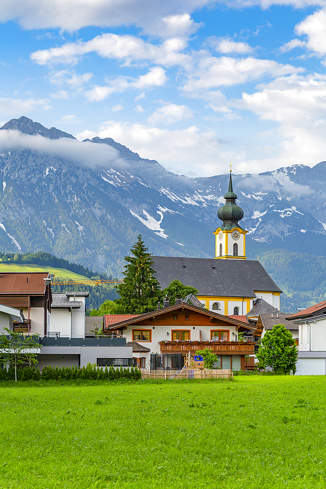 View of Pfarramt Soll Church and mountains in background, Soll, Solllandl, Tyrol, Austria, Europe