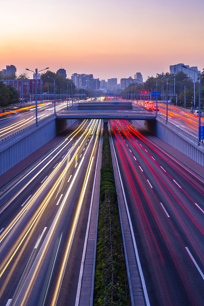 Traffic trail lights on major road near Beijing Zoo at dusk, Beijing, People's Republic of China, Asia - 844-21882