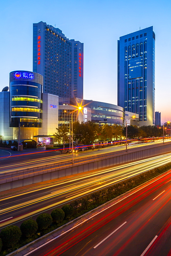 Traffic trail lights on major road near Beijing Zoo at dusk, Beijing, People's Republic of China, Asia - 844-21886