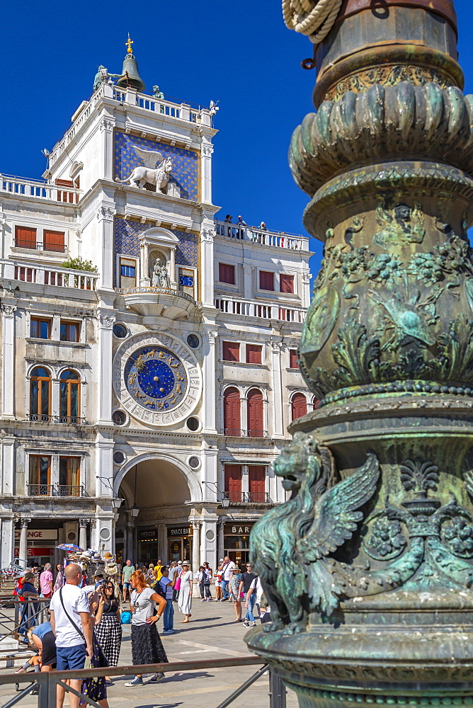 View of Torre dell'Orologio and ornate lamp post in St. Mark's Square, Venice, UNESCO World Heritage Site, Veneto, Italy, Europe