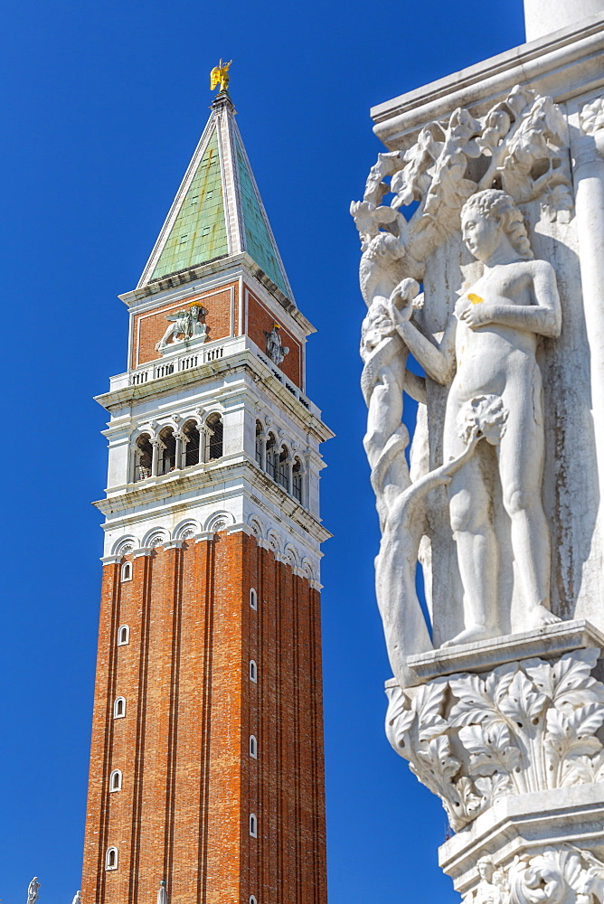 View of the Campanile and sculpture on Doge's Palace in St. Mark's Square, Venice, UNESCO World Heritage Site, Veneto, Italy, Europe
