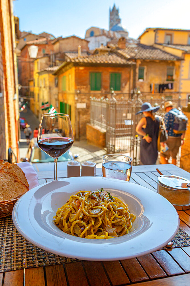 View of traditional Italian cusine, pasta and wine, Siena, Tuscany, Italy, Europe