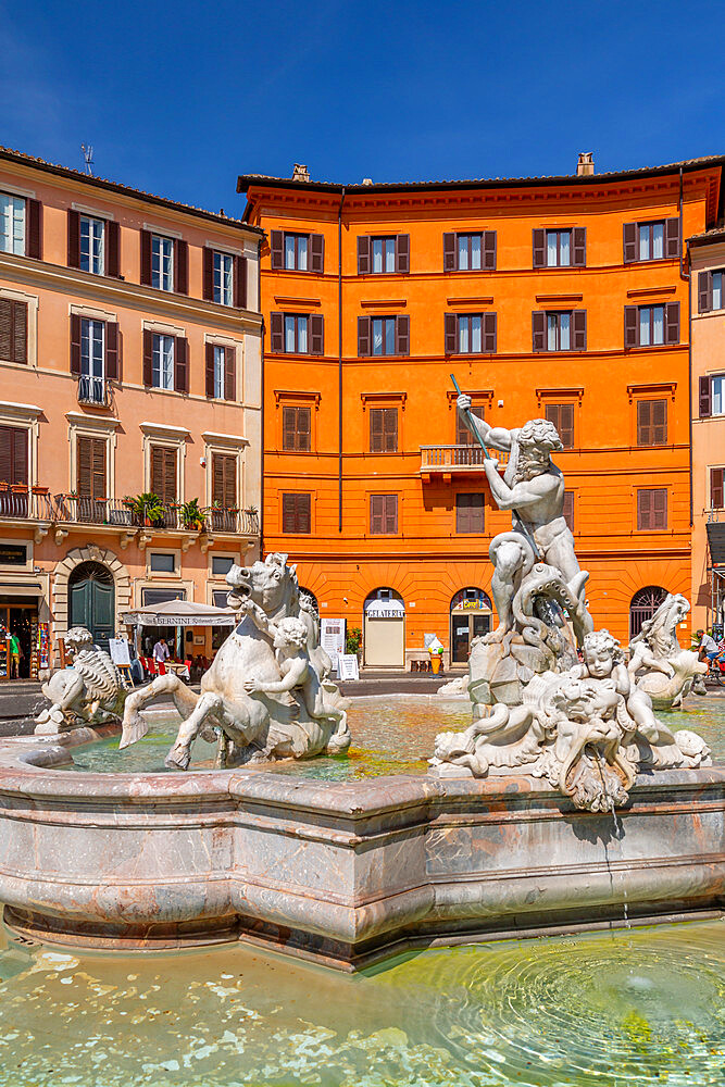 View of the Neptune Fountain and colourful architecture in Piazza Navona, Piazza Navona, UNESCO World Heritage Site, Rome, Lazio, Italy, Europe