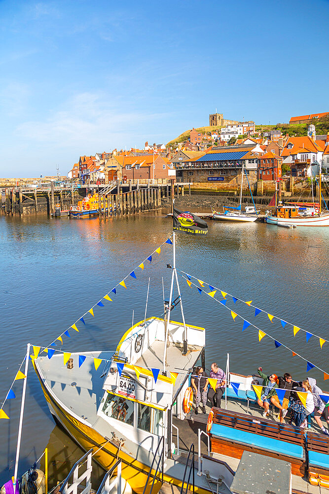 View of St. Mary's Church and restaurants, houses and boats on the River Esk, Whitby, Yorkshire, England, United Kingdom, Europe - 844-23326
