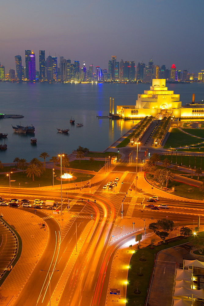 Museum of Islamic Art and West Bay Central Financial District from East Bay District at dusk, Doha, Qatar, Middle East