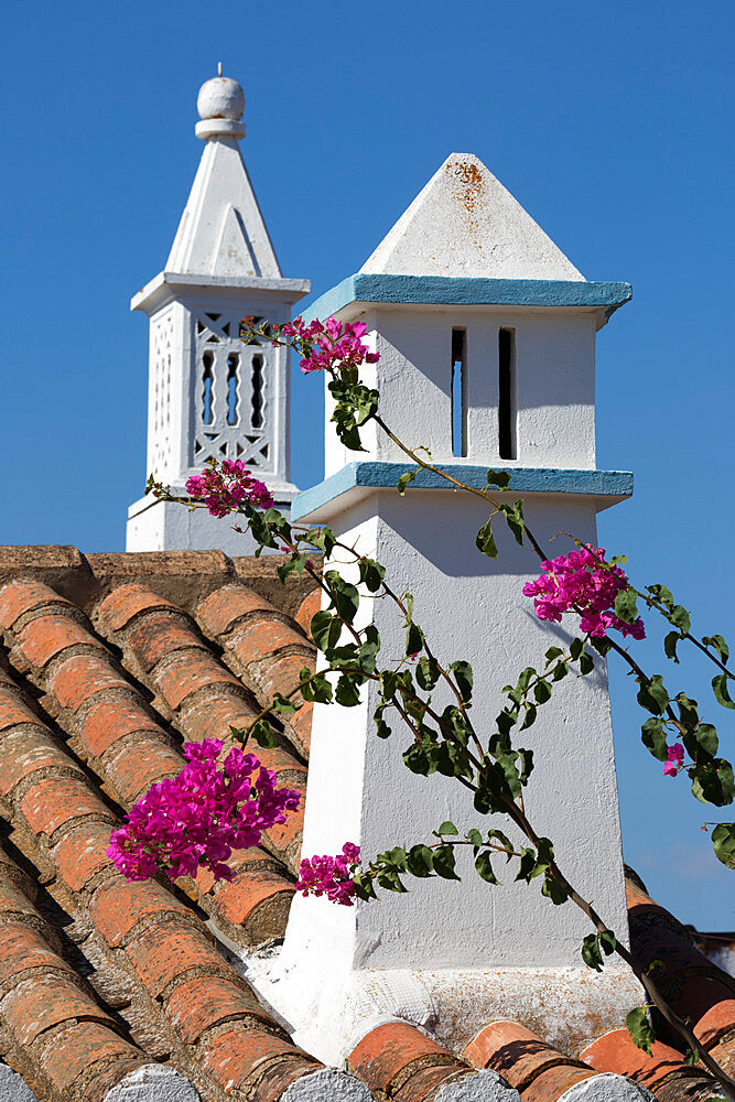 Filigreed chimney pots and Bougainvillea, Algarve, Portugal, Europe