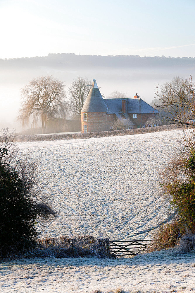 Old oast house in winter frost, Burwash, East Sussex, England, United Kingdom, Europe