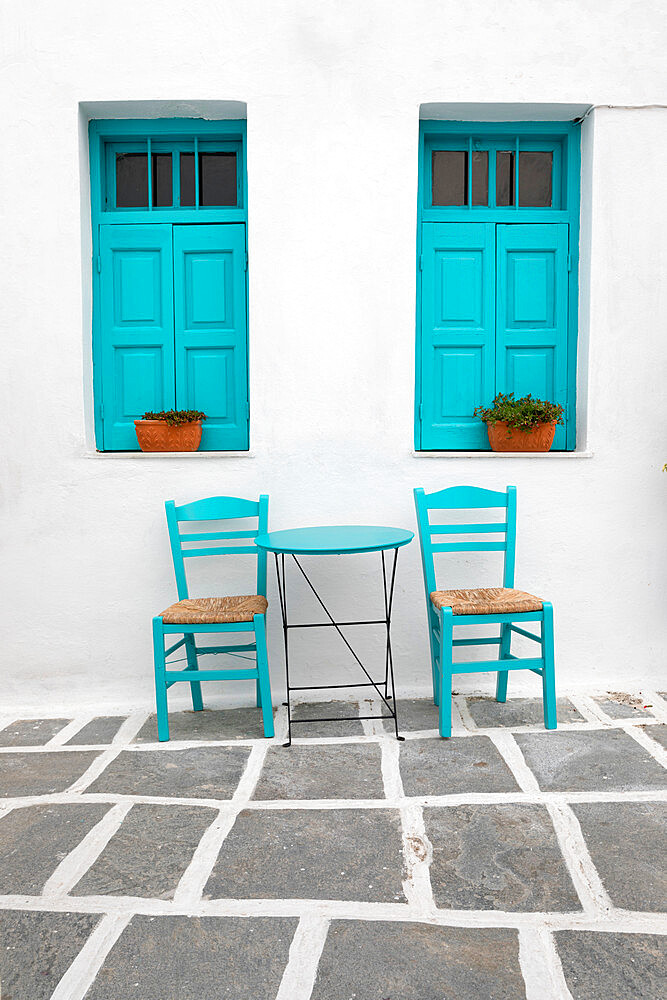Typical Greek cafe table and chairs with shuttered windows, Pano Chora, Serifos, Cyclades, Aegean Sea, Greek Islands, Greece - 846-2849
