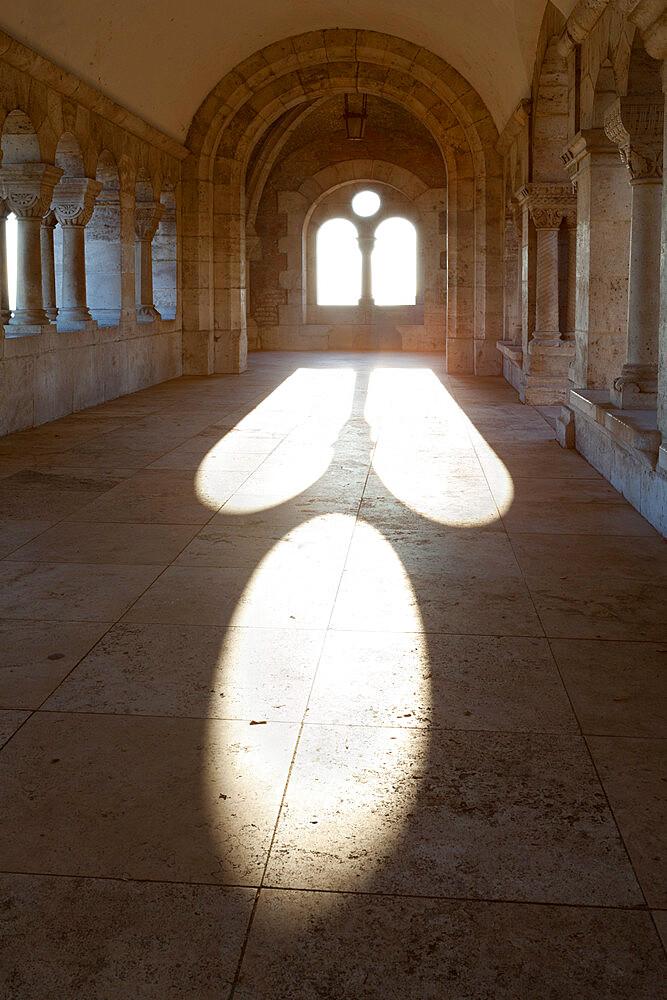 Sunlight pouring through arched windows, Fishermen's Bastion (Halaszbastya), Buda, Budapest, Hungary, Europe - 846-462