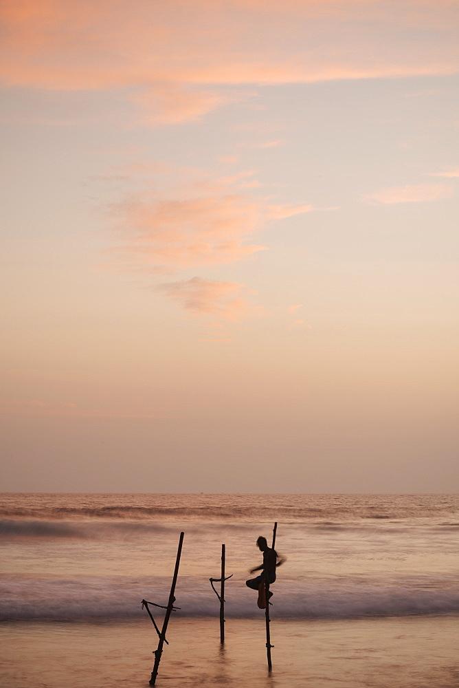 Stilt Fishermen at dusk, Weligama, South Coast, Sri Lanka, Asia - 848-1829