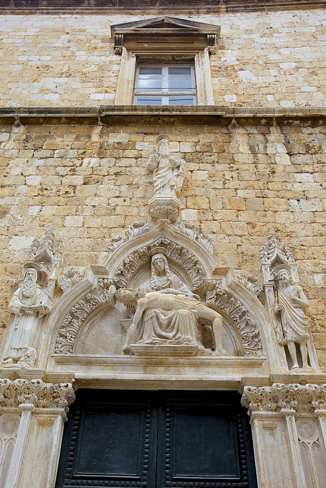 Statue of Our Lady of Sorrow and St. John the Baptist on the portal of the Franciscan church, Dubrovnik. Croatia, Europe