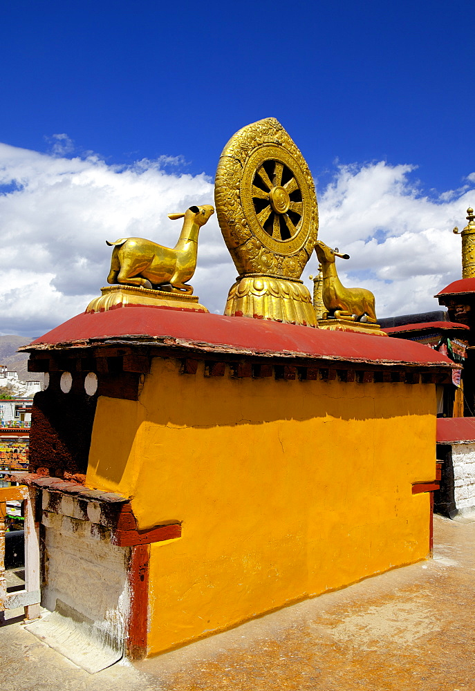 Golden Wheel of Dharma and deer sculptures on the sacred Jokhang Temple roof, Barkhor Square, Lhasa, Tibet, China, Asia