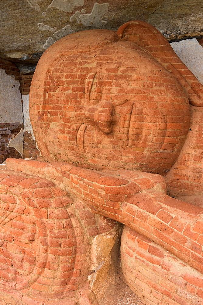 Reclining Buddha statue at Pidurangala Rock Cave Temple, Sigiriya, Sri Lanka