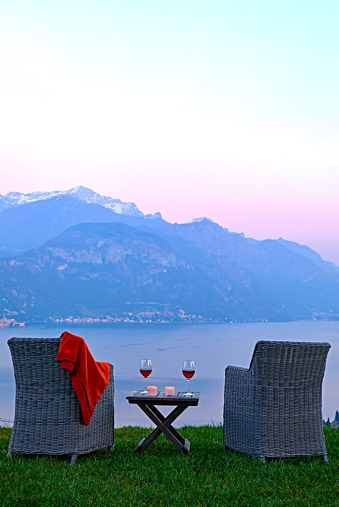 Armchairs and red wine with views of Lake Como at sunset, Lombardy, Italian Lakes, Italy, Europe - 851-954