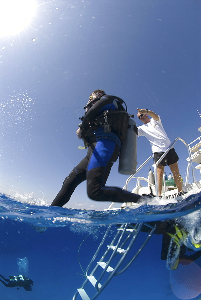 Technical Divers using Trimix, entering water from dive boat, Divetech, Grand Cayman, Cayman Islands, Caribbean - 970-784