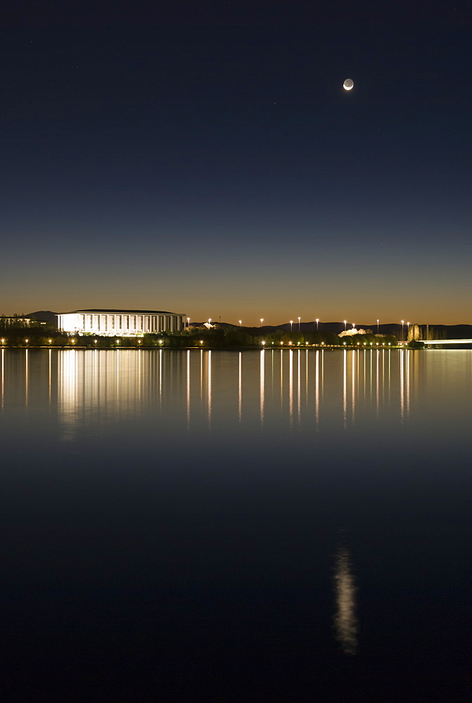 New moon above Australian National Library and Lake Burley Griffin, Canberra, Australian Capital Territory, Australia