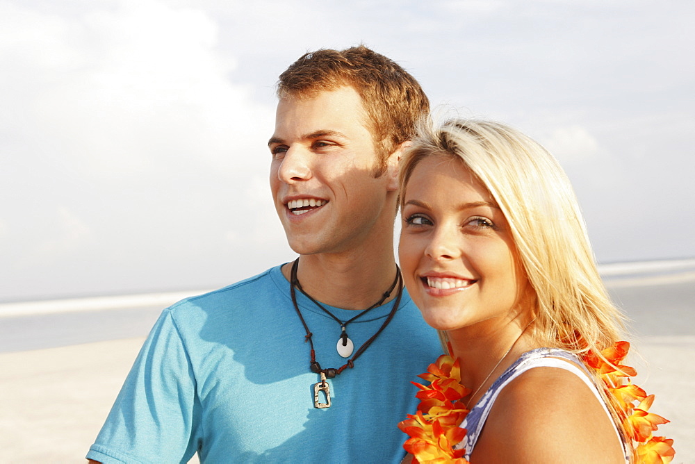 Young couple posing on beach