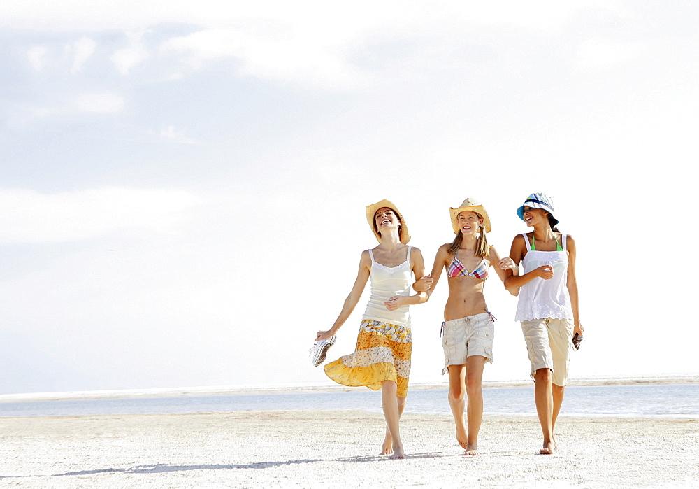 Friends walking in beach