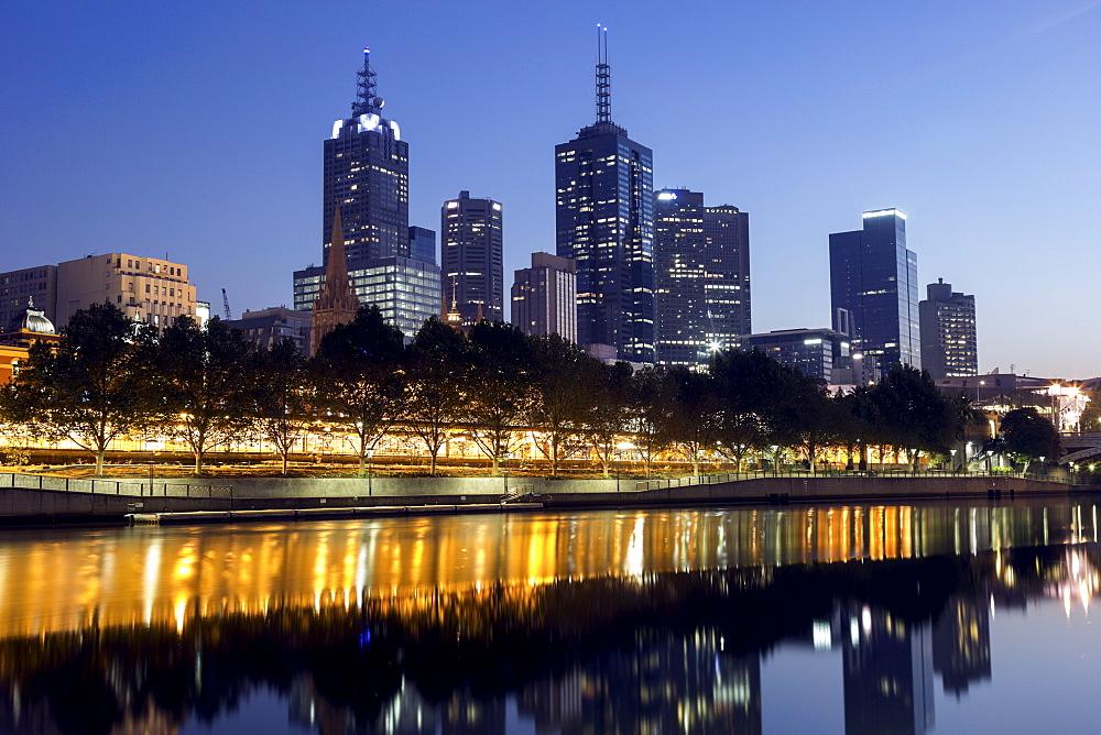 Cityscape with reflection in Yarra river, Melbourne, Victoria, Australia