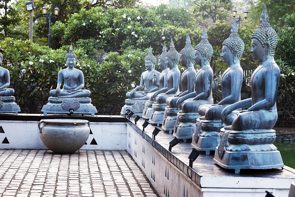 Buddha statues in Gangaramaya Temple, Sri Lanka, Colombo