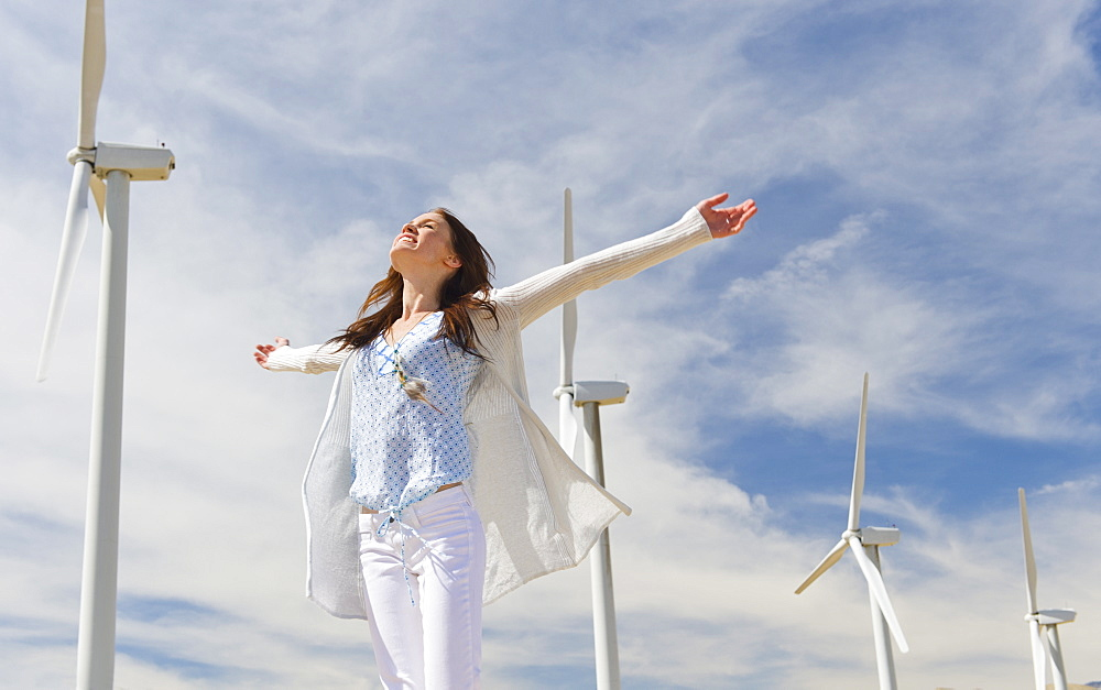 Young woman at wind farm