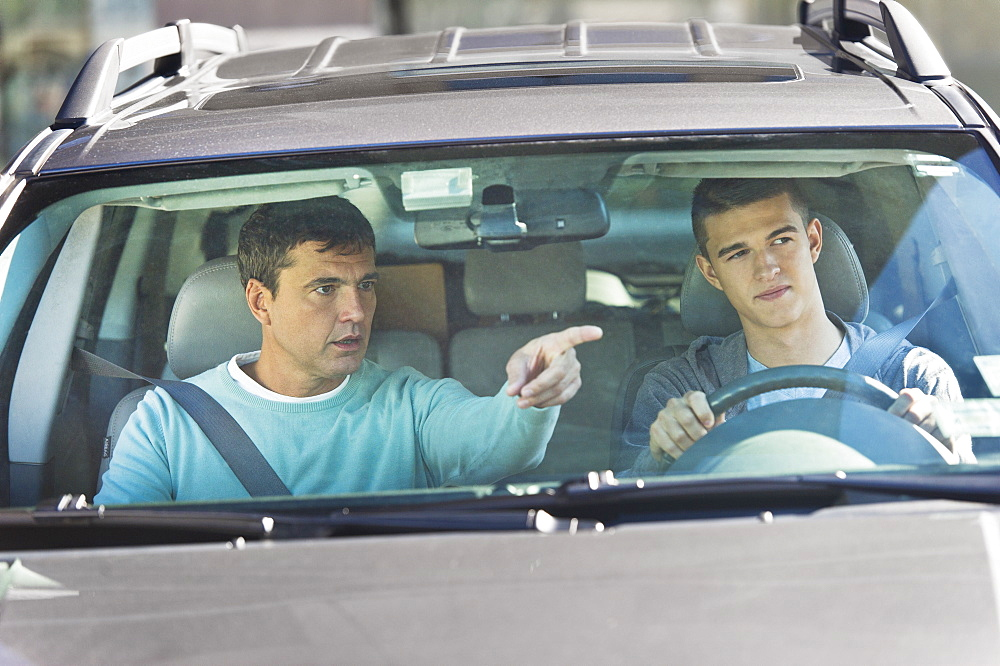 Father with teenage (16-17) son driving