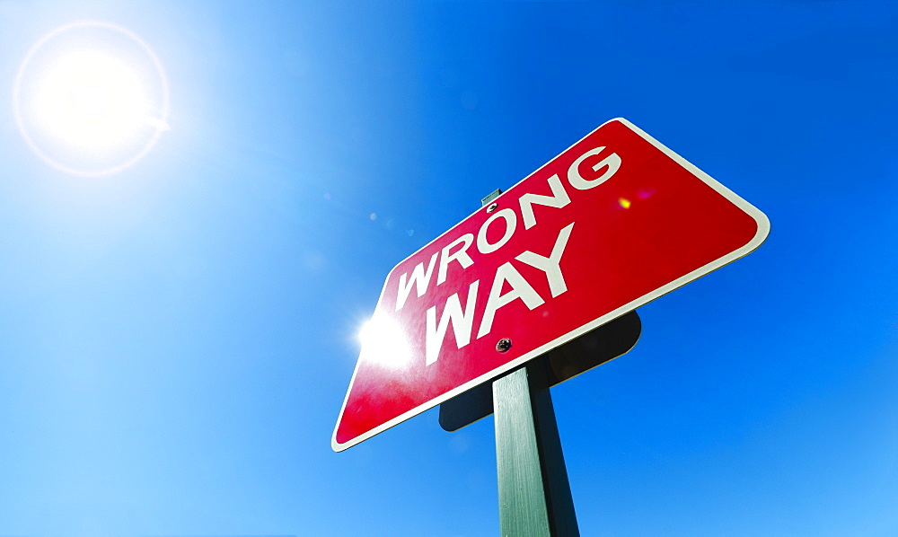 """Low angle view of """"wrong way"""" sign - 1178-13597"""