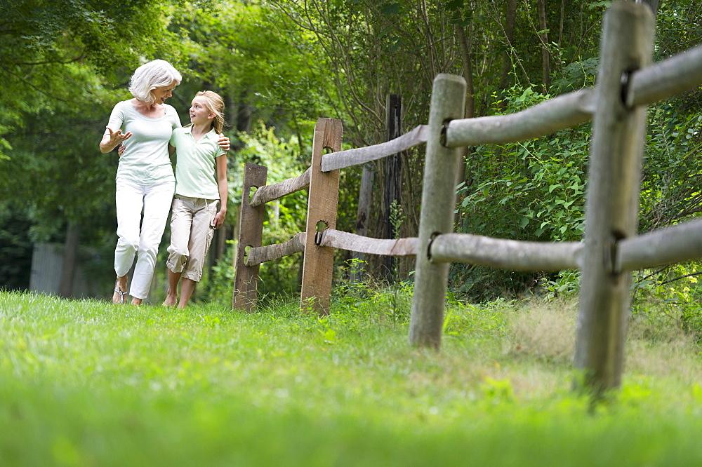 Girl (10-11) and grandmother walking together