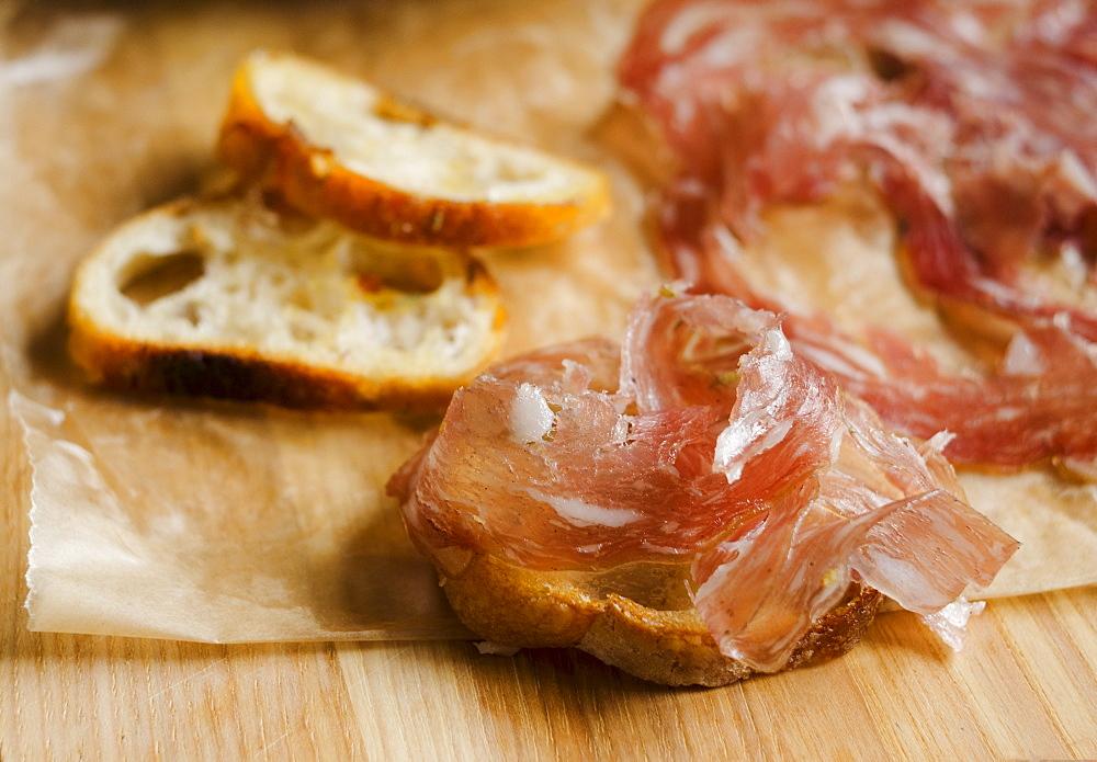 Fresh prosciutto ham with bread