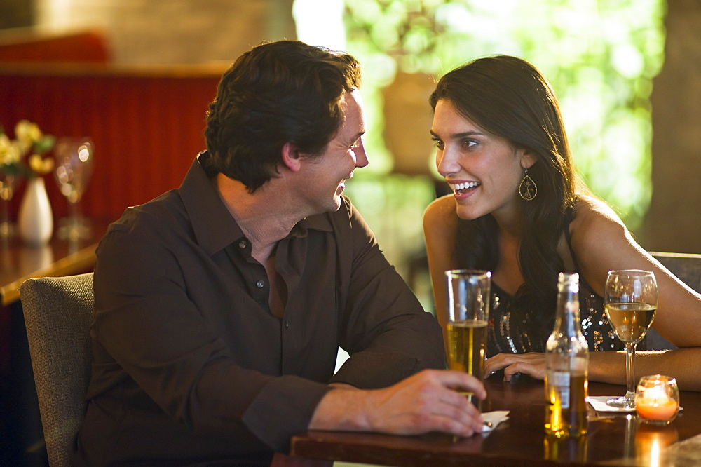 Couple drinking in restaurant