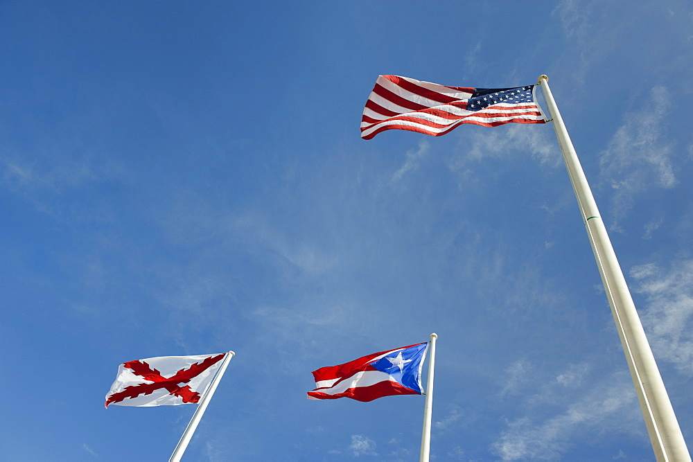 Puerto Rico, Old San Juan, low angle view of flags under blue sky