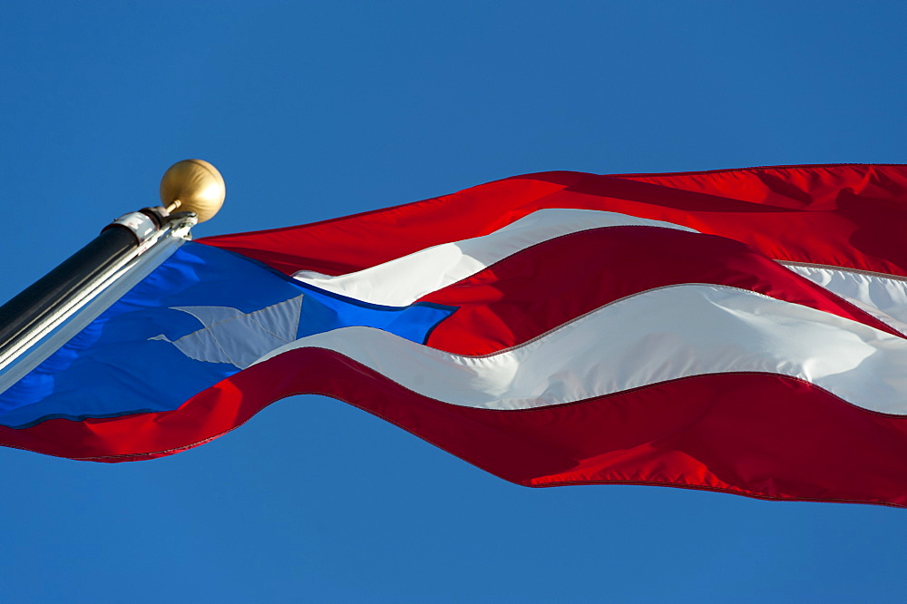 Puerto Rico, Old San Juan, Close up of Puerto Rican flag against blue sky