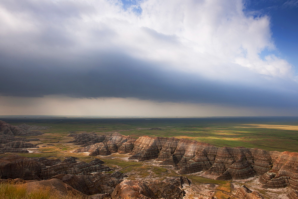 USA, South Dakota, Thick gray clouds over mountains in Badlands National Park