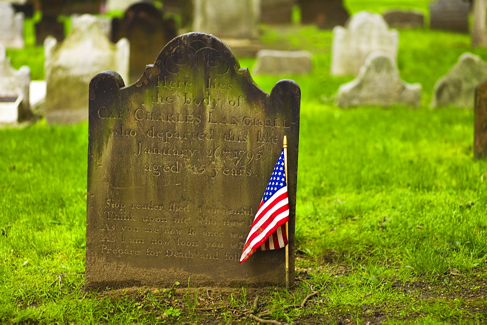 American flag in front of tombstone