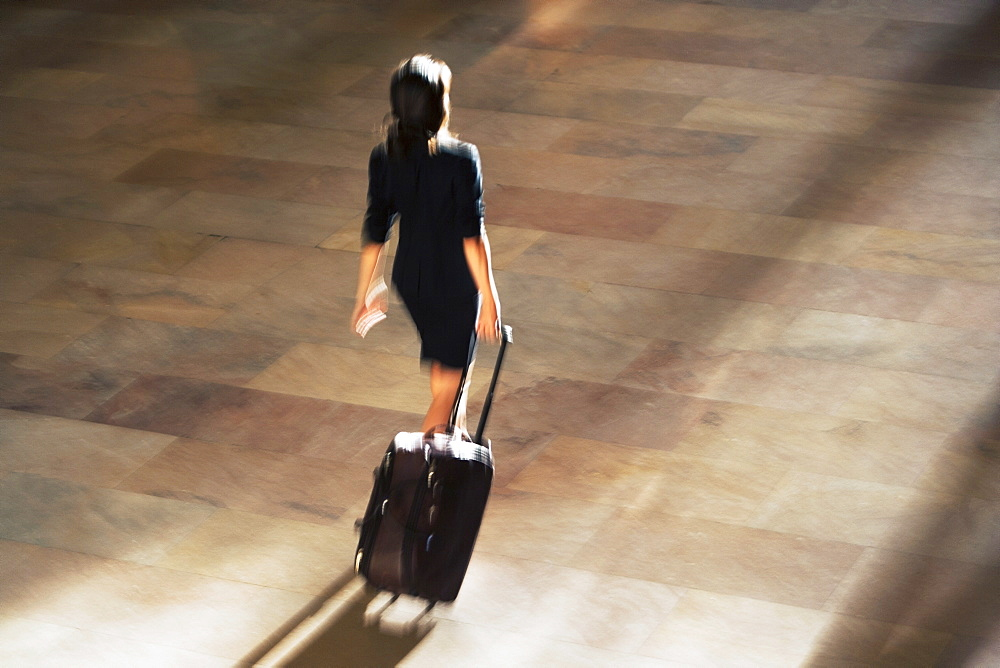High angle view of woman walking at Grand Central Station, USA, New York State, New York City