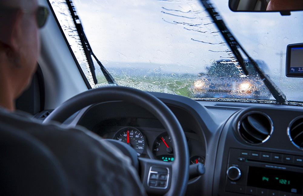 Man driving in rain, USA, Utah