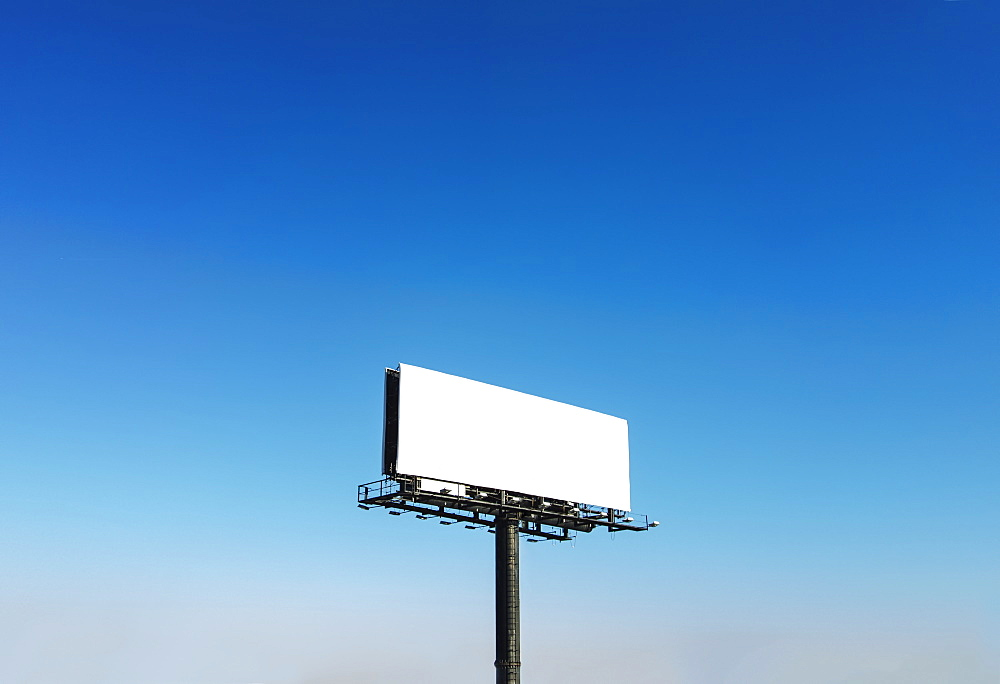 Billboard under blue sky