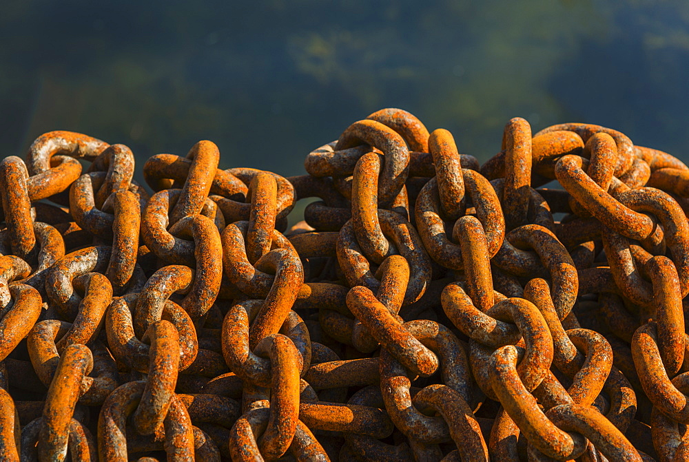 Rusty chains in harbor
