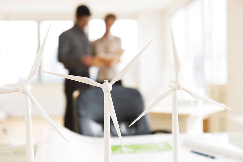 Scale models of wind turbines on office desk
