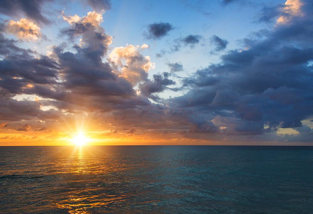 Sun setting over sea, Jamaica