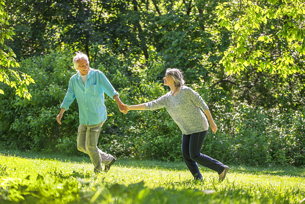 Senior couple running in park, Central Park, New York City