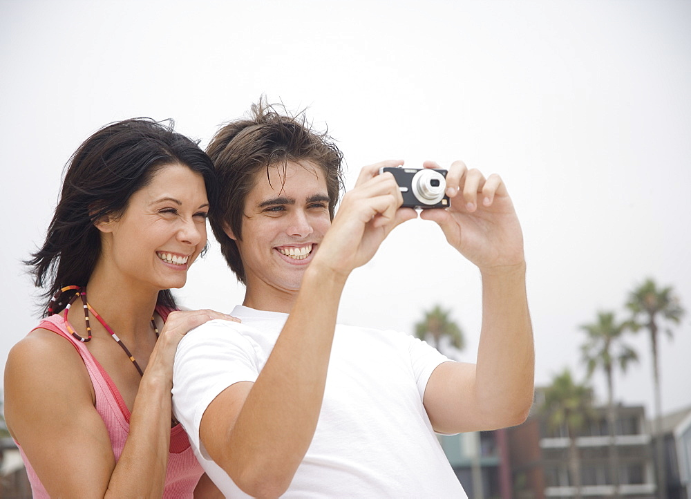Couple taking photograph outdoors