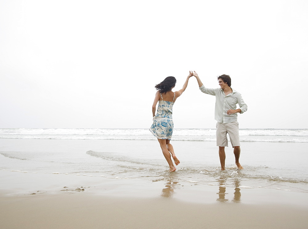 Couple dancing at beach