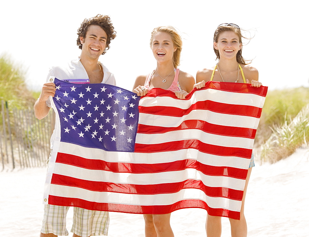 Friends holding American flag