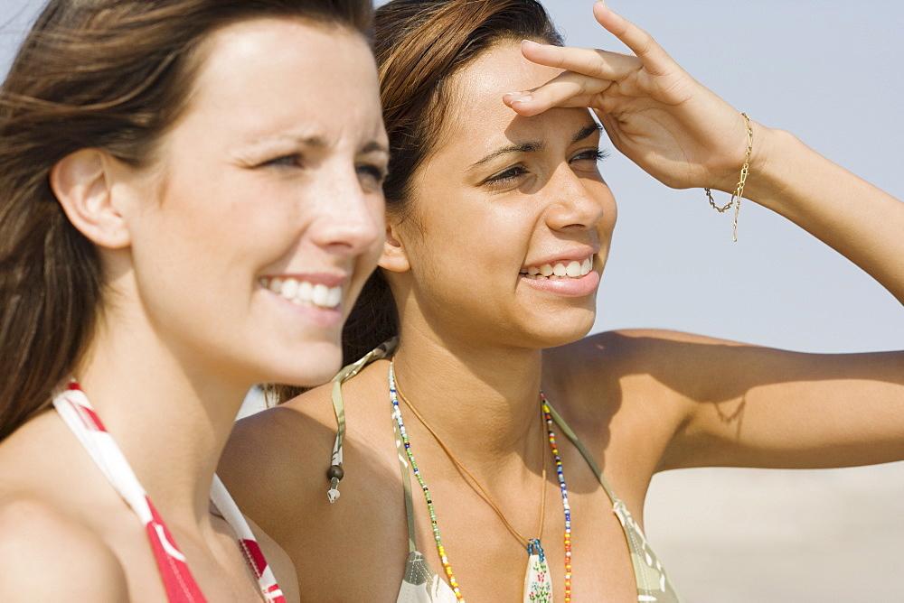 Young women wearing bikinis
